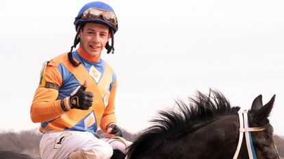 Jockey Weston Hamilton won his first race as an Eclipse Award champion Sunday at Laurel Park, guiding P & H Stables and C & B Stables' Weekend Flyer to a 3 ½-length win in the fourth race.