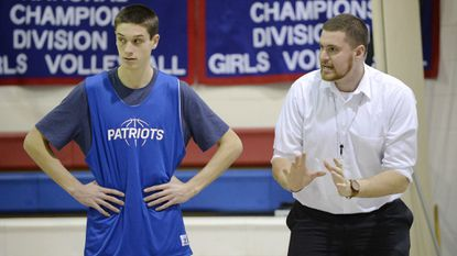 Basketball coach Jon Andrews, right, works with junior Joshua Mathews during a practice in Westminster Thursday, Dec 14, 2017.