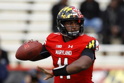 Maryland quarterback Kasim Hill throws to a receiver in the first half of an NCAA college football game against Illinois, Saturday, Oct. 27, 2018, in College Park.