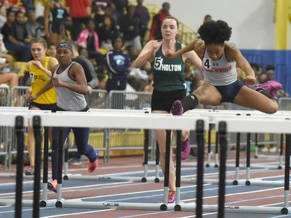 Adaobi Tabugbo of Reservoir, right, and Kimayah Faye, second from left, compete in the 55-meter hurdles during the 2018-19 Howard County indoor track and field championships. Tabugbo, Faye and teammate Kat Parris swept the 55 hurdles at the 2019-20 county championship in January.