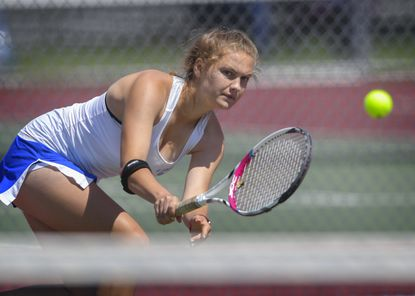 Liberty's Grace Johnson return a backhand against South Carroll's Casey Reno in the girls' singles final during the Carroll County tennis championships held at Liberty High School in Eldersburg Monday.