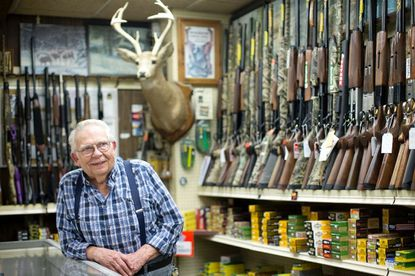 Clyde Blamberg poses for a photo at Clyde's Sport Shop. The family store has been in business for 60 years.