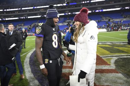 Baltimore Ravens quarterback Lamar Jackson (8) talks with Fox sideline reporter Erin Andrews after an NFL football game against the New York Jets, Thursday, Dec. 12, 2019, in Baltimore. The Ravens won 42-21. (AP Photo/Nick Wass)