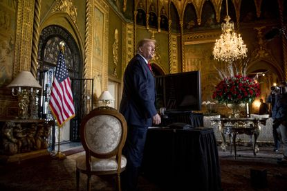 FILE - In this Dec. 24, 2019, file photo President Donald Trump speaks to members of the media at his Mar-a-Lago estate in Palm Beach, Florida. Donald Trump's supporters appear more restless and ready for civil war without him. . (AP Photo/Andrew Harnik, File)