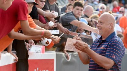 Cal Ripken, Jr. signs autographs before throwing a ceremonial first pitch at Friday's home game between the Aberdeen IronBirds and the Connecticut Tigers in Aberdeen.