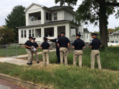 Police canvass for tips in transgender woman's fatal shooting in Northwest Baltimore.