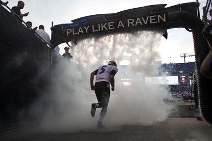 Ravens quarterback Joe Flacco runs out to the field before the start of a preseason exhibition game against the New Orleans Saints at M&T Bank Stadium.