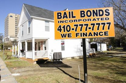 Complaints about conspicuous signs for bail bonds businesses in East Towson prompted a bill to restrict signage.The owner of Bail Bonds Inc. now says he will challenge the law.