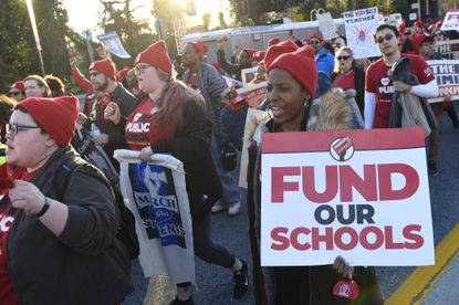 In this Monday, March 11, 2019 file photo, hundreds of teachers, parents and students participate in a rally near the state capital in Annapolis when Baltimore's union members asked for fans to be donated to sweltering classrooms that lack air-conditioning. (AP Photo/Susan Walsh, File)