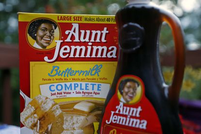 This is a box of Aunt Jemima Buttermilk Pancake and Waffle Mix and a bottle of Aunt Jemima Original Syrup in Farmington, Pa., Thursday, June 18, 2020. (AP Photo/Gene J. Puskar)