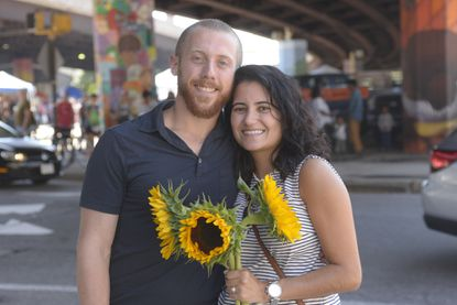 Matt Leyden proposed to Andrea Olsen while she purchased sunflowers at the Baltimore Farmers' Market & Bazaar on Sunday, August 13, 2017.