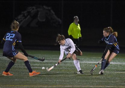 Marriotts Ridge #14, Sophia Baxter advances the ball in the 2nd quarter, Opening-day field hockey game between River Hill and Marriotts Ridge, at Marriotts Ridge High School, March 8, 2021. River Hill won 2-1