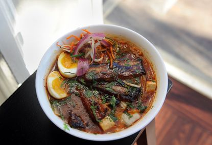The five-spiced barbecue pork belly in a kimchi broth at Mi and Yu Noodle Bar on South Charles Street.