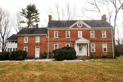 The exterior of the Quinn house on Sweet Air Road, which dates back to 1751, is a rare example of Flemish bond pattern brick. Peter and Anna Woytowitz have lived here since 1970.