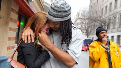 Sabein Burgess wipes tears from one of his lawyers, Susan Friedman, following his release from prison in 2015. A federal jury has awarded Burgess $15 million in his unlawful conviction suit, which Baltimore officials on Wednesday vowed to appeal.