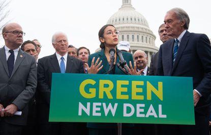 Rep. Alexandria Ocasio-Cortez, Democrat of New York, and Sen. Ed Markey (R), Democrat of Massachusetts, speak during a press conference to announce Green New Deal legislation to promote clean energy programs.