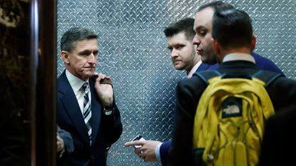 Retired Lt. Gen. Michael Flynn, left, and his son Michael G. Flynn, second from left, board an elevator at Trump Tower in New York on Nov. 17, 2016.