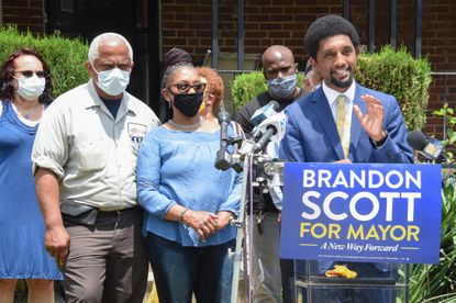 City Council President Brandon Scott accepts the Democratic nomination for mayor of Baltimore outside his grandparents' house near where he grew up in Park Heights on Wednesday. June 10, 2020.