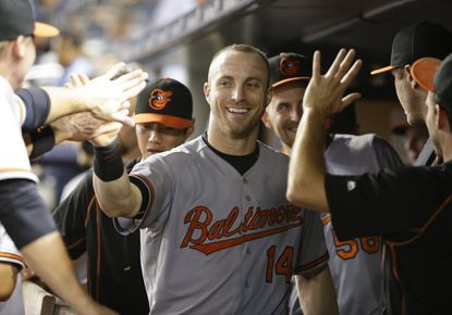 Orioles' Nolan Reimold (14) celebrates with teammates after scoring a run during the ninth inning against the New York Yankees on Wednesday, Sept. 9, 2015, in New York.