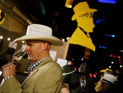 Cameron Denton savors a glass of at last year's Hats Off to Hampden, a gala fundraiser to raise money for the Hampden Family Center.