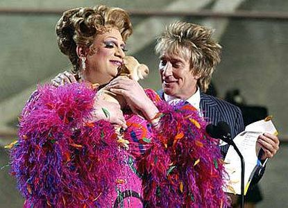 Presenters Rod Stewart (right) and Harvey Fierstein (as Edna Turnblad) present at the Grammys.
