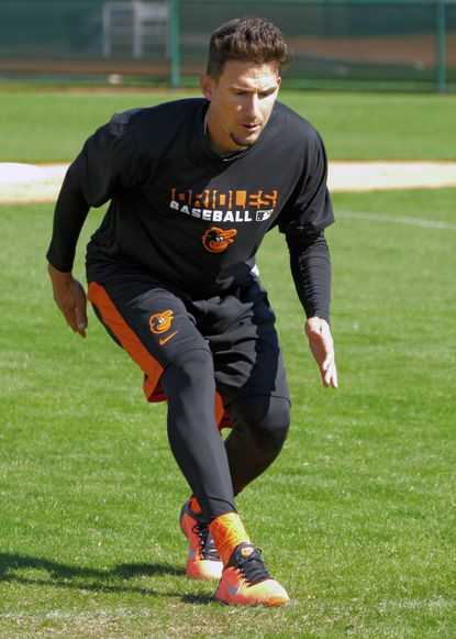 Orioles infielder Ryan Flaherty participates in a drill during spring training at the Ed Smith Stadium complex in Sarasota, Fla.