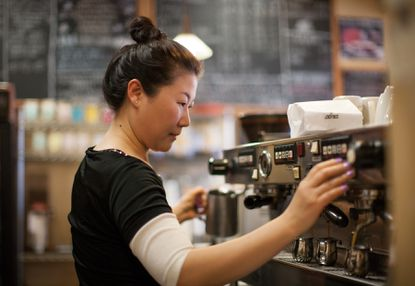 Lakeside Cafe employee Stephanie Pyon, of Columbia, makes espresso based drinks at a machine behind the bar at the lakefront location.