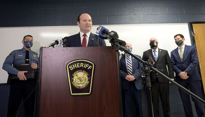 Surrounded by, from left, Carroll County Sheriff Jim DeWees, County Commissioner Stephen Wantz, Special Agent in Charge Tim Jones of the BATF Baltimore Field Office and Assistant US Attorney Paul Budlow, Acting US Attorney for the District of Maryland ,Jonathan Lenzner speaks during a press conference Thursday, March 11, 2021 announcing federal charges against an Ohio man accused in an October package bomb attack near Manchester.