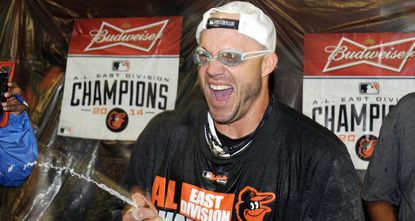 Steve Pearce celebrates in the clubhouse after the Orioles clinched the American League East division title at Camden Yards.
