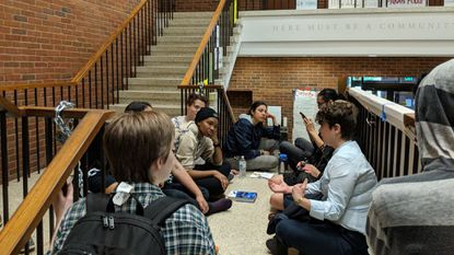 Protesters at Johns Hopkins University chain themselves to stairs inside an administrative building Wednesday. The students want the university to end contracts with ICE and stop the creation of a private police force.