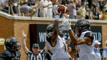 Simpson sets tone, T. Flacco throws for four touchdowns as No. 23 Towson upsets No. 13 Stony Brook