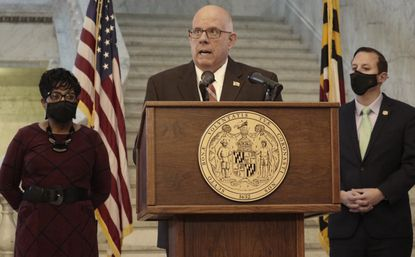 Maryland Gov. Larry Hogan, a Republican, discusses American Rescue Plan Act spending during a news conference with legislative leaders on Wednesday, March 31, 2021 in Annapolis. House Speaker Adrienne Jones, a Democrat, is standing left, and Senate President Bill Ferguson, a Democrat, is standing right. (AP Photo/Brian Witte)