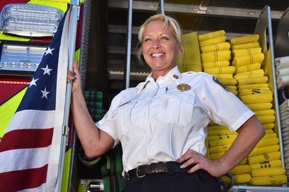 Howard County Fire Chief Christine Uhlhorn, on a new fire truck at the Fire and Rescue Services headquarters. A third generation firefighter, Uhlhorn is the first female to become chief of the county's department.