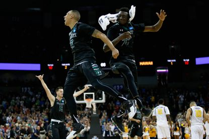 Quincy Smith (11) and Sheriff Drammeh (22) of the Hawaii Rainbow Warriors celebrate the Warriors' 77-66 win over the California Golden Bears during the first round of the 2016 NCAA tournament at Spokane Veterans Memorial Arena on March 18, 2016 in Spokane, Wash.