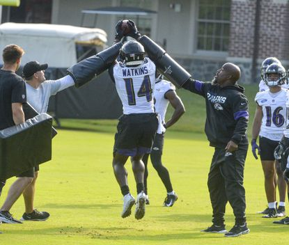 Ravens wide receiver Sammy Watkins tries to catch a pass during a drill in training camp at the Under Armour Performance Center.