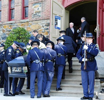 Pallbearers carry the casket of Aberdeen Police OFC Charles Armetta into St. Stephen Church in Kingsville for his funeral Friday.