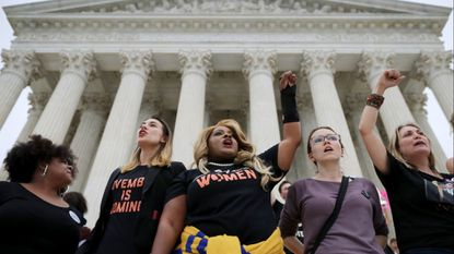 Protesters on the steps of the Supreme Court after over running police barricades while demonstrating the confirmation of Brett Kavanaugh October 06, 2018. The protesters marched up to the doors of the court as Kavanaugh was inside taking his oath.
