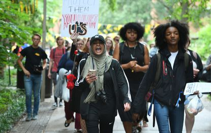 UMBC students march to the administration building last year to protest the university's handling of sexual assault claims. There were similar protests at Johns Hopkins.