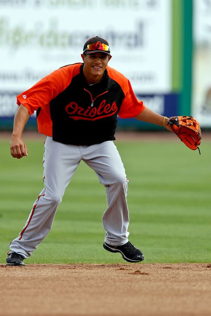 Baltimore Orioles shortstop Manny Machado fields during batting practice before a spring training game.