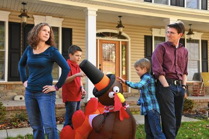 Erin Lavelle, left, and Chris Lavelle, with their sons, Salvatore, 10, and Dario, 6, third from left, make up one of many American householdsthat will be dealing with divided political opinions this Thanksgiving.