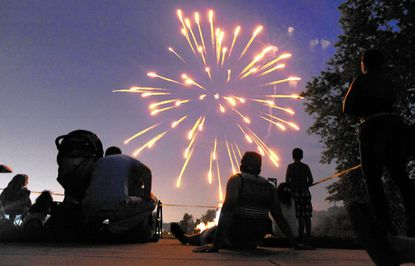 Spectators watch the annual fireworks display at Loch Raven Technical Academy, in Loch Raven Village, last July. Organizers say they need donations of money and time to ensure the event's continuation.