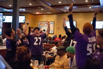 Fans at Champps in Columbia cheer as the Ravens win the AFC championship game.