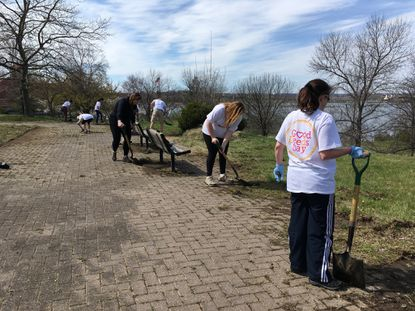 Volunteers clean up Middle Branch Park in South Baltimore for Good Deeds Day.