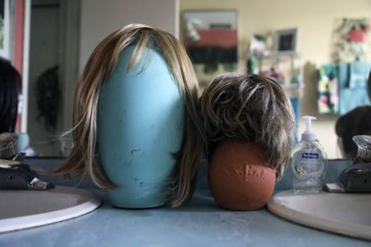 Wigs at the home of Annrene Rowe in Anna Maria, Fla., on Sept. 18, 2020. Rowe was hospitalized for 12 days with coronavirus symptoms earlier this year; since then, she has noticed her hair falling out in clumps.