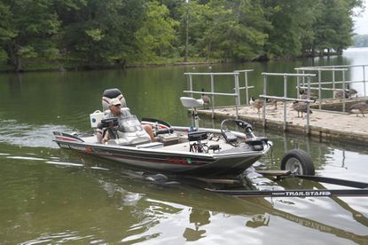 Dana Seipp of Hampstead drives his boat on to a trailer at the Loch Raven Fishing Center last summer.