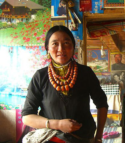 """Tibetan nomad Lhamotso can earn $1,000 a week during the brief season gathering caterpillar fungus. """"It's only in the last two years it has gotten so expensive,"""" she says, """"It's crazy, but it is good for us. How else would I make so much money? I can't read or write."""""""