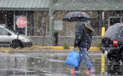 A coastal storm brought a wintry mix of rain and snow the day before Thanksgiving.