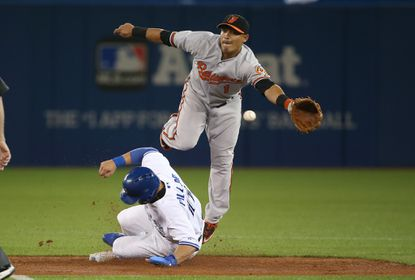 Kevin Pillar of the Toronto Blue Jays steals second base in the third inning as Everth Cabrera (1) of the Baltimore Orioles cannot handle the throw on April 22, 2015 at Rogers Centre in Toronto.