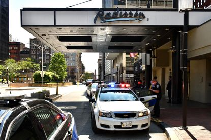 Police activity surrounding the Radisson Hotel in the 100 block of W. Fayette St. required the closure of that block and the 100 block of N. Liberty St. Sunday morning. The streets were reopened by 10 a.m.