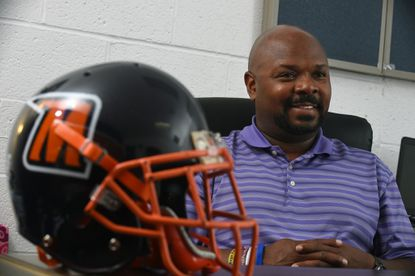 Morgan State University interim head football coach Fred Farrier gets ready for the team's season opening game against his alma mater College of Holy Cross.